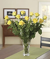 One dozen yellow roses in a crystal vase