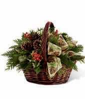 Holly, hypericum berries and Winter greens in basket