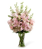 Pink rose and lily sympathy floral arrangement