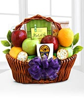Apples, crackers and cheese in basket with red bow