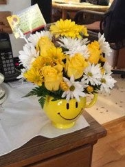 Smiley face yellow flower bouquet customer picture