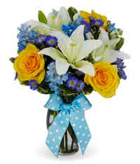 Orange roses, white lilies and blue filler flowers