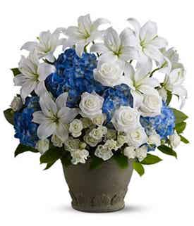 White lilies and blue flowers for sympathy