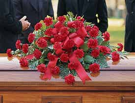 Red floral casket spray