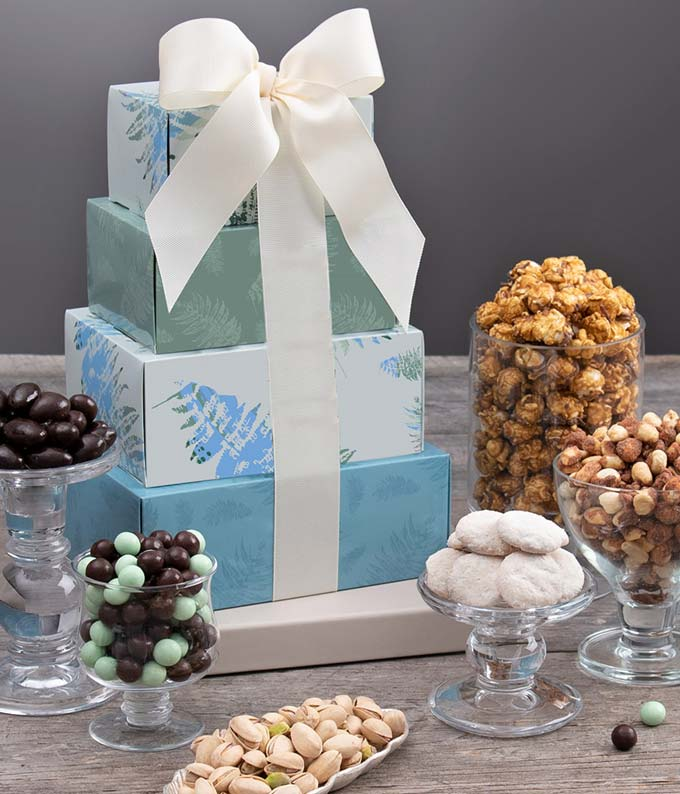 Holiday blue gift basket with caramels, almonds, cookies and more