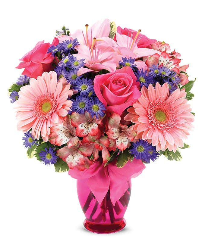 Pink Gerber daisies, pink roses and pink alstroemeria in a pink vase
