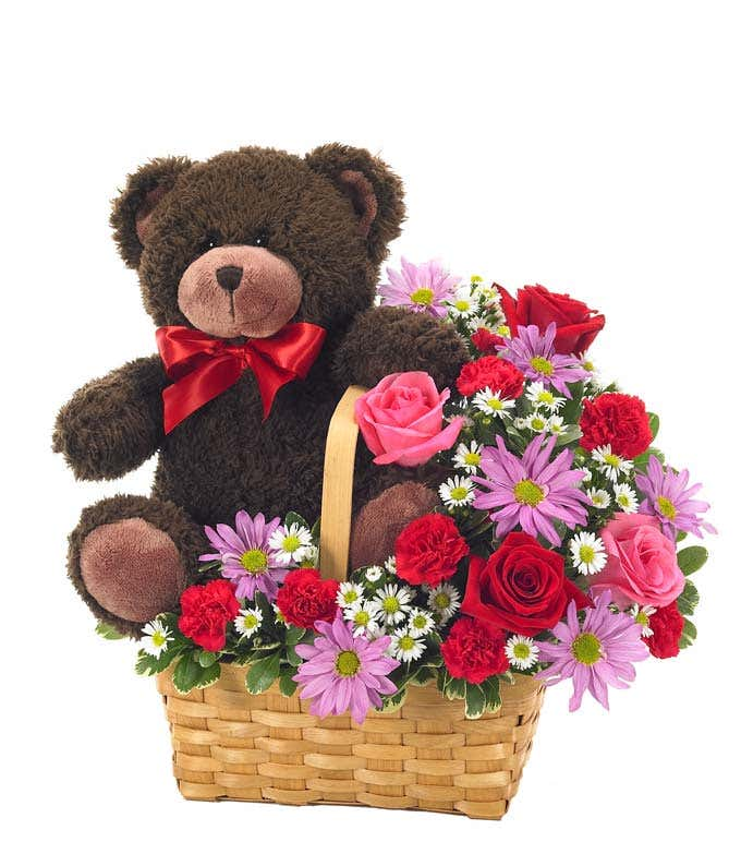 teddy bear delivered with roses in woven basket