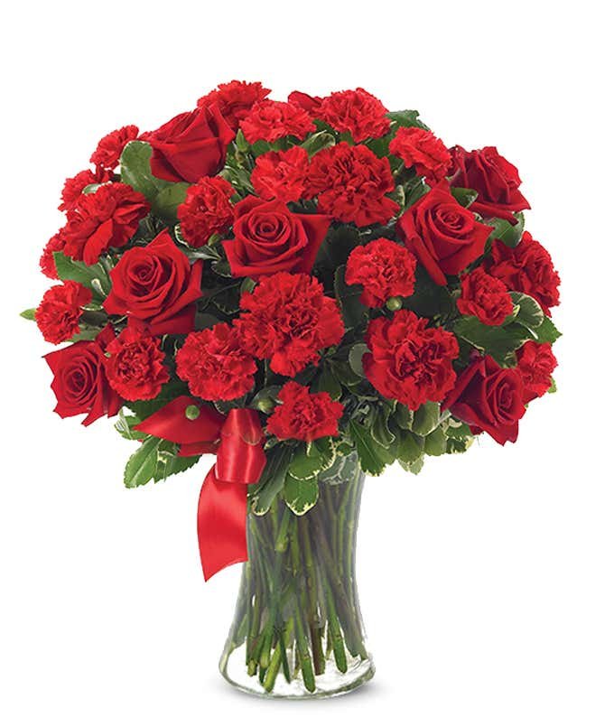 Red Roses And Carnations In Gl Vase