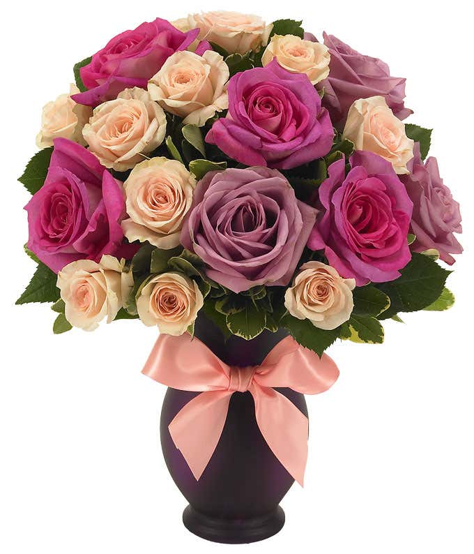 Purple roses and pink roses deliveried in a purple vase