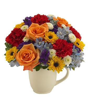 Orange roses, red carnations delivered in mug container
