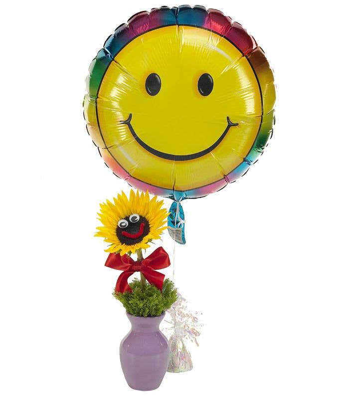 Sunflower arranged with smiley face balloon