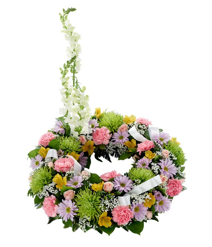 Funeral Wreath with pink carnations and purple flowers