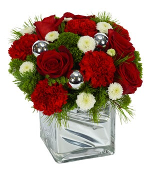 Holiday arrangement with red roses, white poms and red carnations