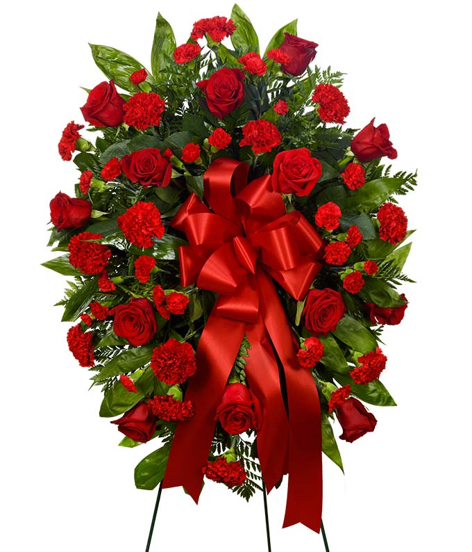 Sympathy standing spray with red flowers