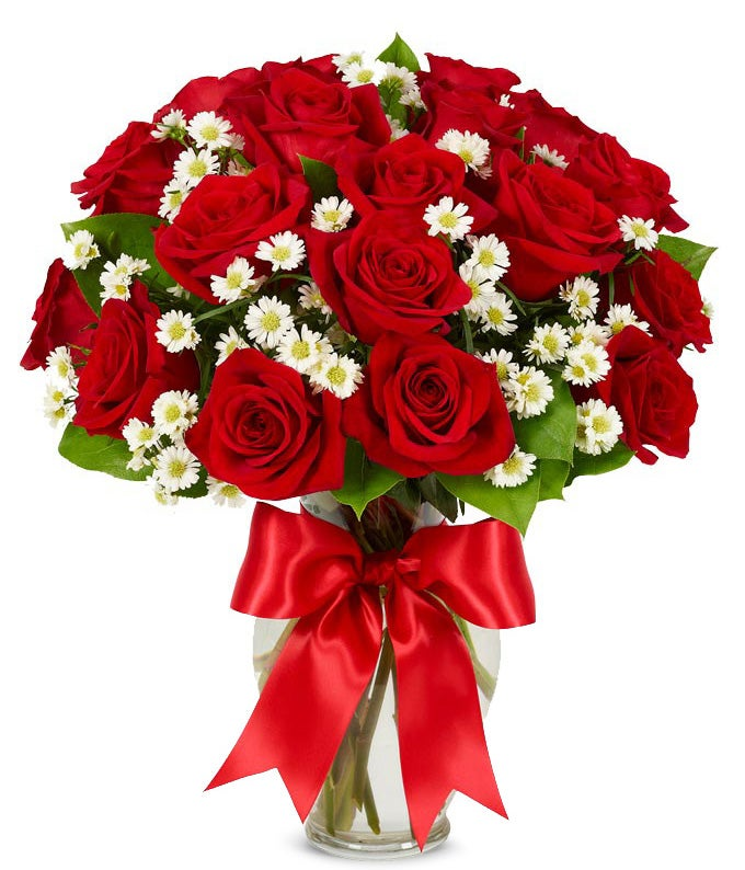 One dozen red roses delivered in glass vase with bow