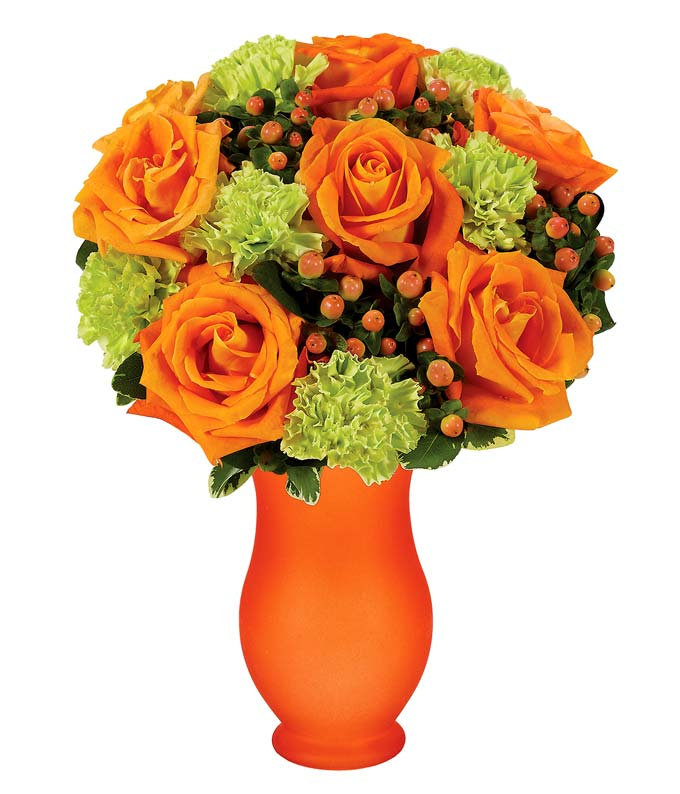 orange roses, green carnations and hypericum berries