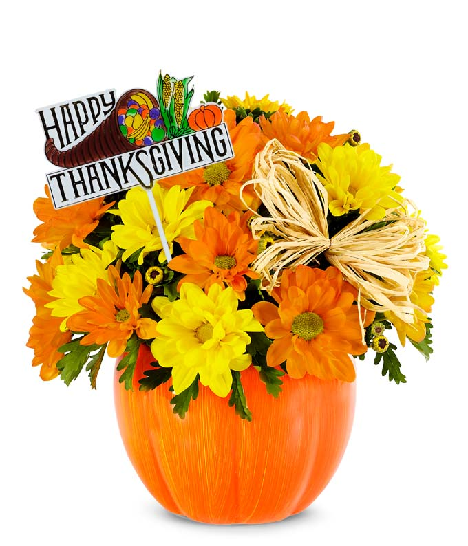 Pumpkin vase with Thanksgiving decoration and Fall flowers