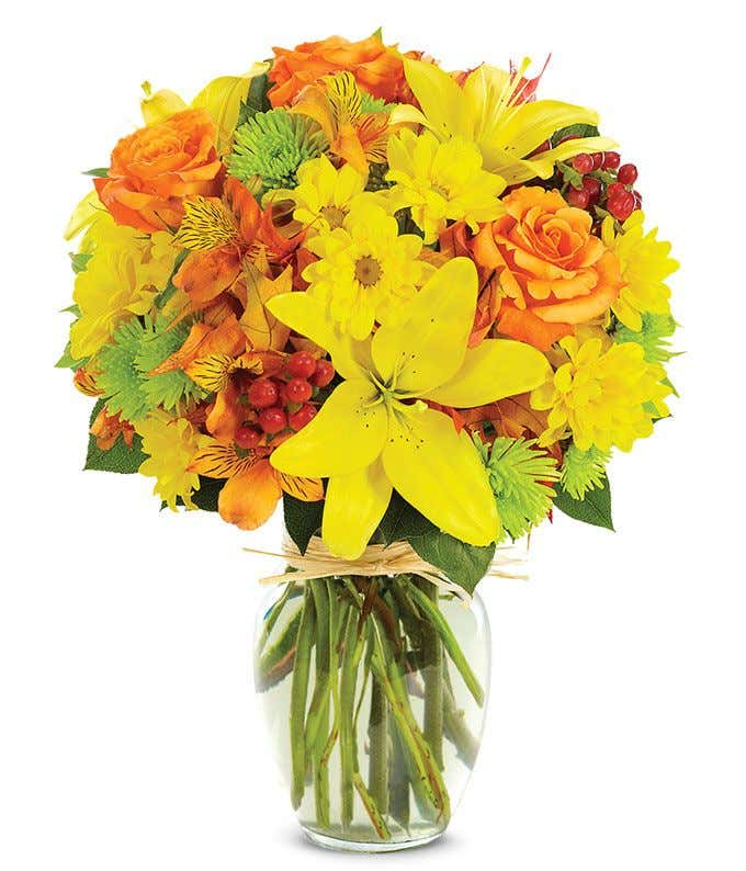 yellow lilies, orange roses and green poms