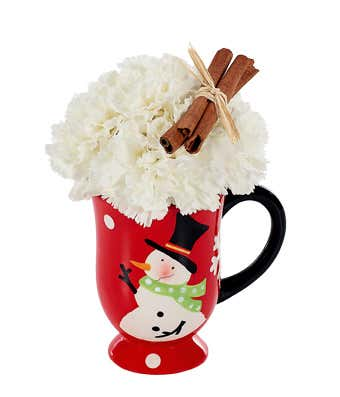 White carnations in snowman mug