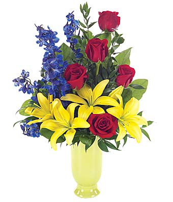 Flower bouquet or red roses, yellow lilies and blue delphinium