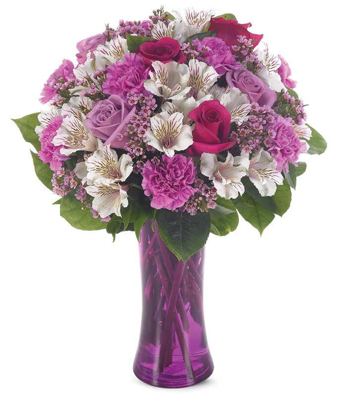 Purple roses, purple carnations and wax flower bouquet