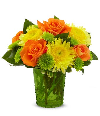 Orange roses and yellow cremon in a hob nob vase