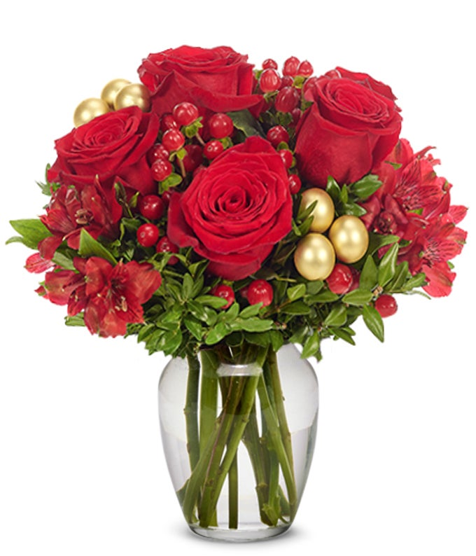 Red roses, red alstroemeria and hypericum in a rectangle vase
