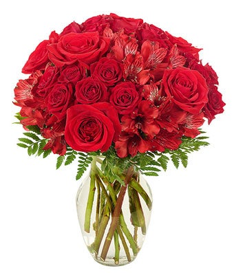 Red rose are arranged with red spray roses and red alstroemeria