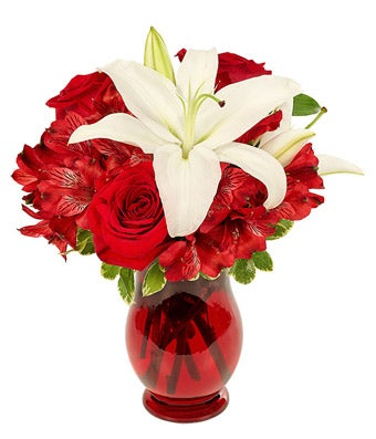 Center lily is surrounded by red roses and red alstroemeria