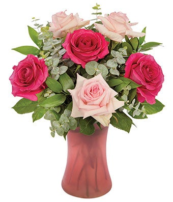 Roses and Eucalyptus bouquet in pink vase
