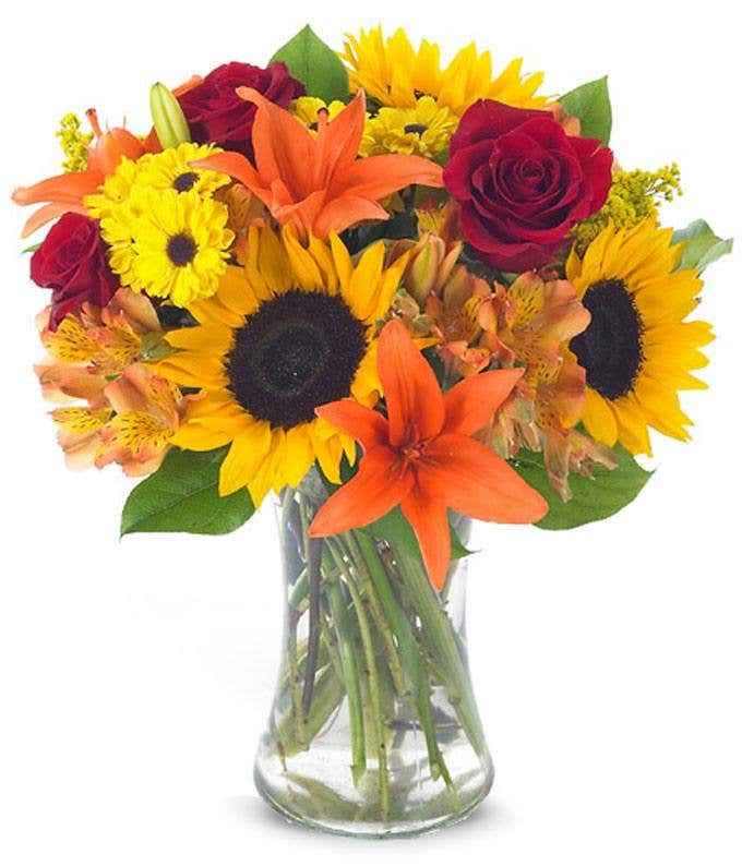 Sunflowers, orange alstroemeria and red roses in bouquet