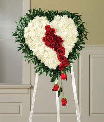Bleeding heart standing spray with red roses