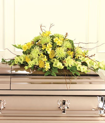 flower casket spray with yellow flowers