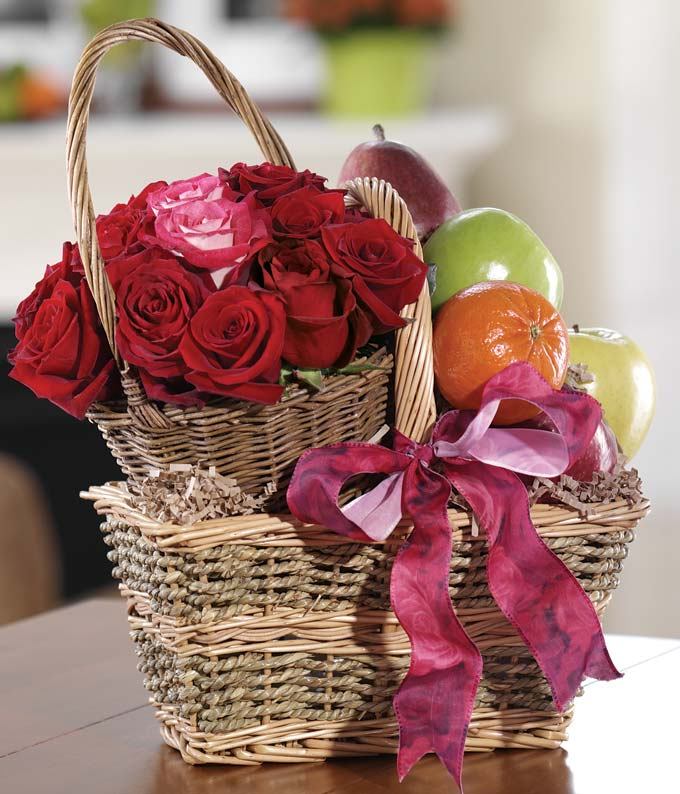 Fresh fruit delivered with red roses in basket
