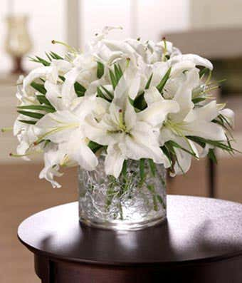 White wondrous at from you flowers white stargazer lilies delivered in a modern circular vase mightylinksfo