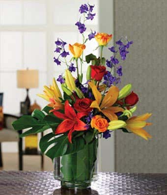 Red and orange lilies and roses
