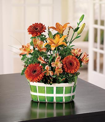 Decorative basket with orange lilies and gerbera daisies