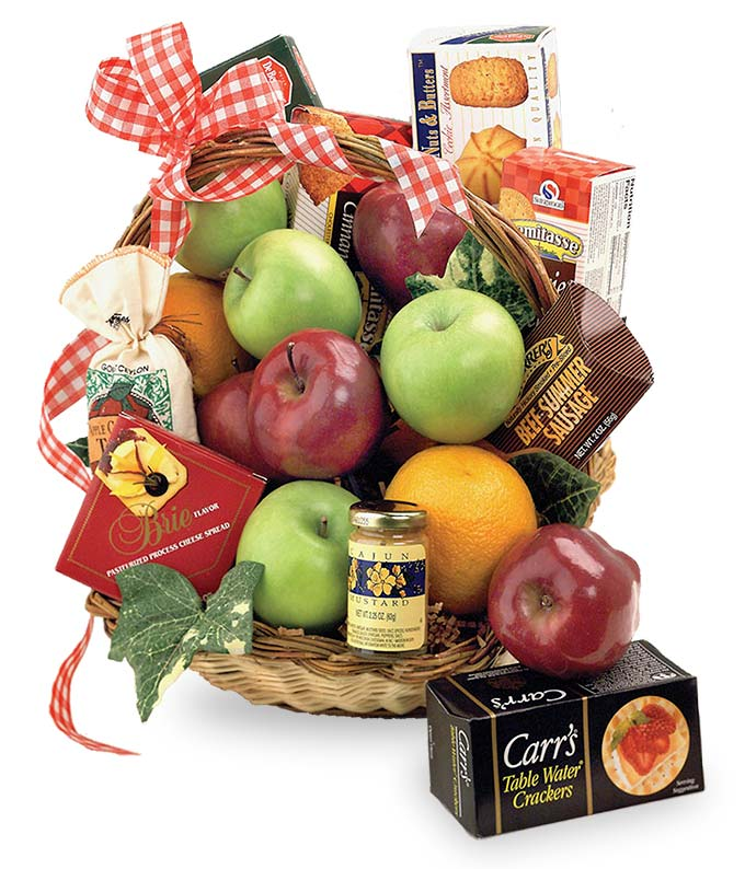 Wicker basket with fruit, crackers and treats