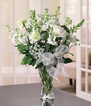 Anniversary flowers with white roses and white snapdragons