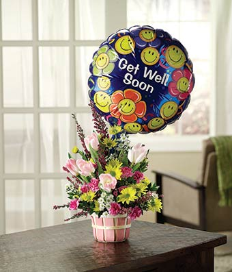 Pink tulips, yellow daisies and purple heather with get well balloon