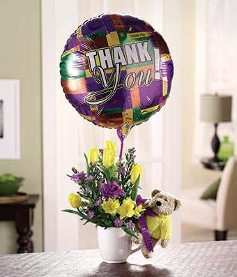 Flowers delivered in a mug with a thank you balloon
