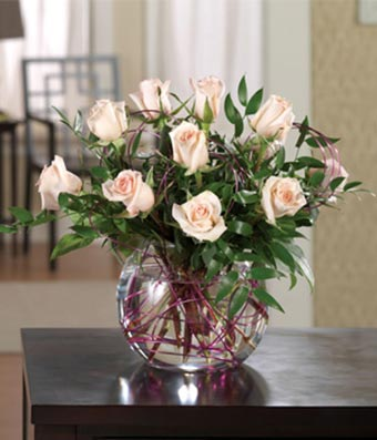 Pink roses delivered in a glass bubble vase & Pink Pleasure Bubble Bouquet at From You Flowers