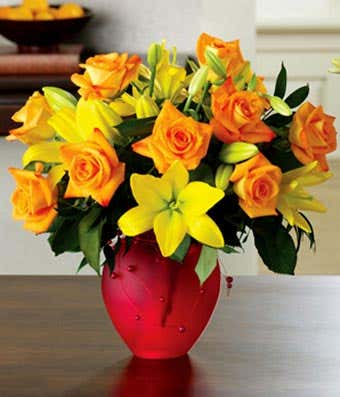 One dozen orange roses and yellow lilies