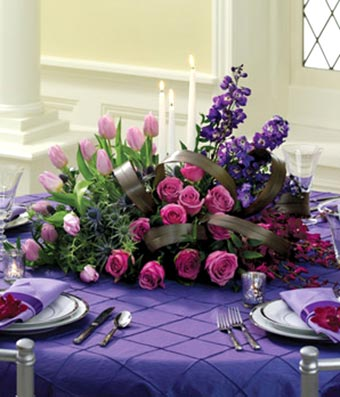 Purple roses and purple tulip in floral centerpiece