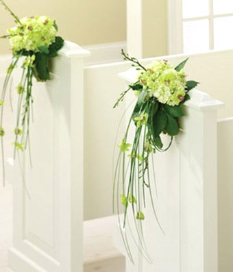 Wedding pew flowers with orchids and hydrangea