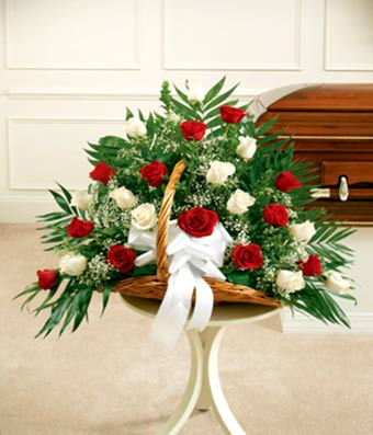 fireside funeral basket with two dozen long stem red roses