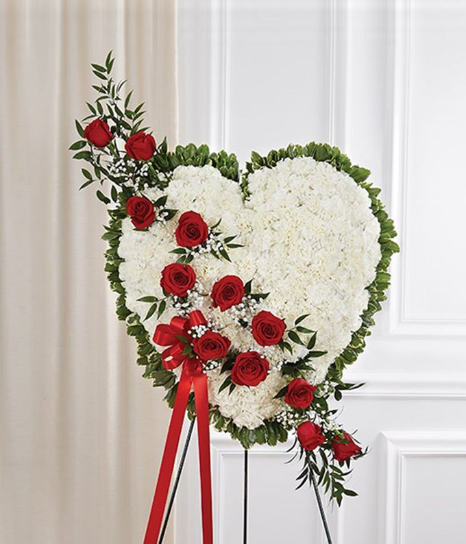 White flowers with red rose break in a heart standing spray