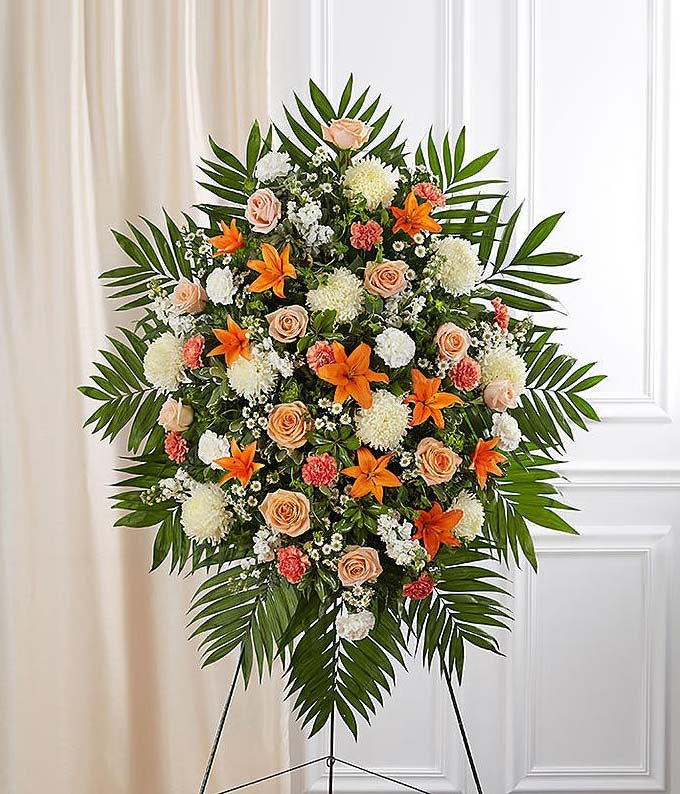 Orange roses and white spider mum funeral standing spray