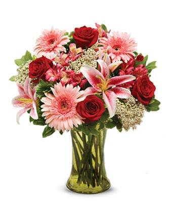 Flowers for sympathy with red roses, pink lilies and pink daisies