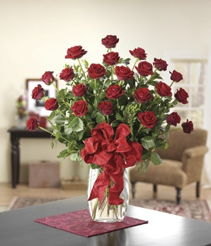 Two doze long stemmed red roses